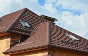 New roofing construction with attic skylights, rain gutter system, roof windows and roof protection from snow board, snow guard exterior.