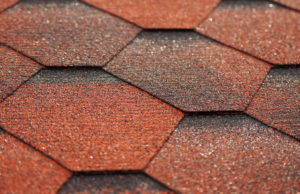 Asphalt shingles roof tiling texture macro photo