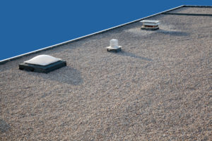 Inverted gravel roof chimney and skylight